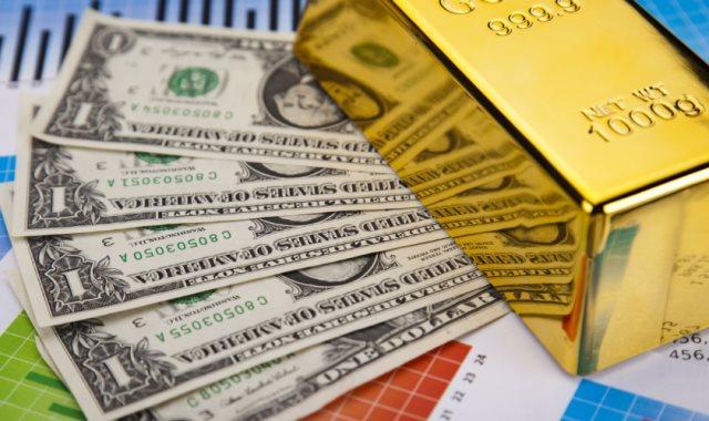 صورة تراجع بسعر الذهب وصعود الدولار بعد توقعات اقتصاديه قويه من الفدرالي الأمريكي
